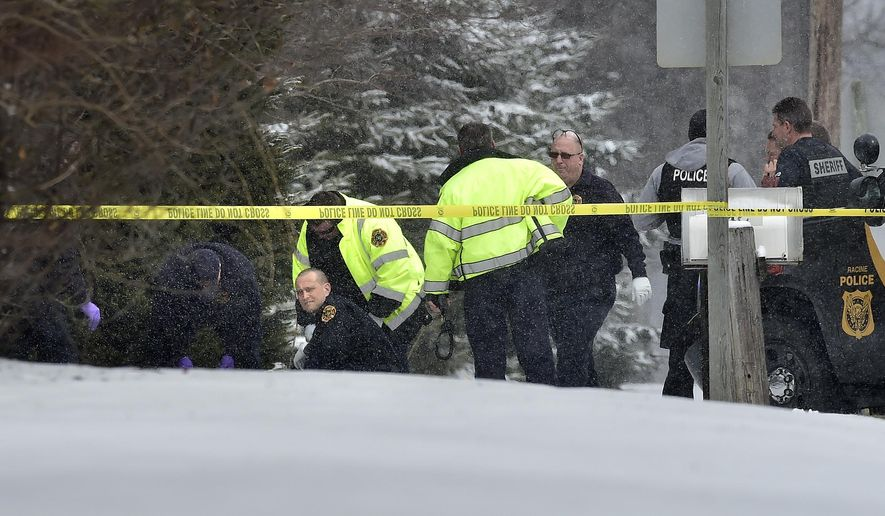 Authorities investigate the scene, after capturing a fugitive accused of abducting a woman from a southeastern Wisconsin hospital and fleeing in an exchange of gunfire, in the Village of Mount Pleasant outside Racine, Wis., Monday, March 23, 2015. The sheriff's office said in a news release that authorities tracked the suspect to the Village of Mount Pleasant, where he was hiding in bushes. (AP Photo/The Journal Times, Scott Anderson)