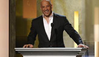 """FILE - In this Feb. 22, 2015 file photo, Vin Diesel speaks on stage at the 45th NAACP Image Awards at the Pasadena Civic Auditorium in Pasadena, Calif. Vin Diesel, who announced Monday, March 23, 2015, on the Today Show that he named his newborn daughter Pauline in honor of his late friend and longtime co-star Paul Walker, revealed that some old advice from Walker had been top of mind in the moment. Vin Diesel, and Walker, co-starred in the """"Fast & Furious"""" franchise. (Photo by Chris Pizzello/Invision/AP, File)"""