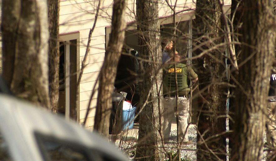 In this image taken from video, federal agents execute a search warrant at the Sapphire, N.C., home of Jose Lantigua on Monday, March 23, 2015. Lantigua, a Jacksonville businessman reported dead two years ago in Venezuela, was arrested in North Carolina on Saturday, March 21, on alleged fraud charges after his life insurance companies filed a lawsuit alleging he was alive and they shouldn't be making payments. (AP Photo/Alex Sanz)
