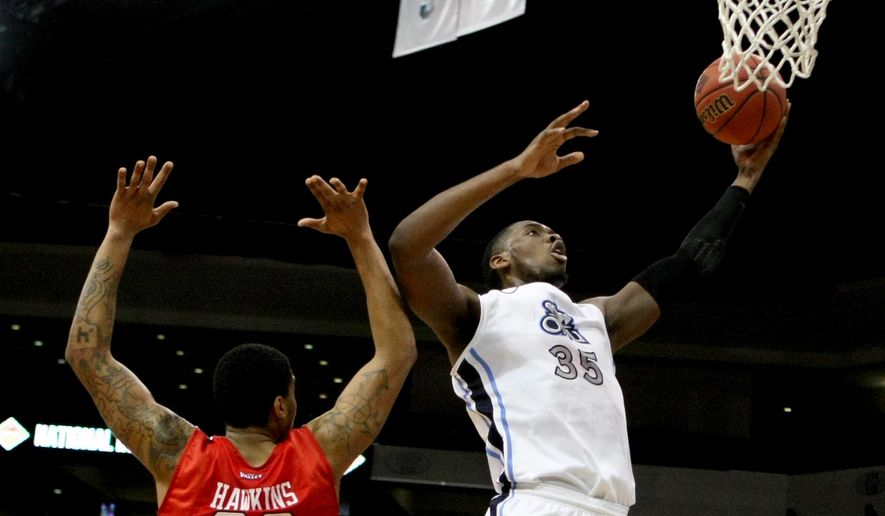 Old Dominion's Jonathan Arledge drives past Illinois State's Deontae Hawkins (23) during the first half of an NCAA college basketball game in the National Invitation Tournament, Monday, March 23, 2015 in Norfolk, Va.   (AP Photo/Jason Hirschfeld)