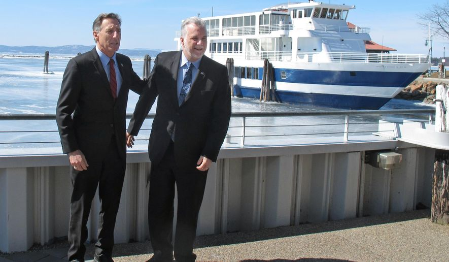 Vermont Gov. Peter Shumlin, left, and Quebec Premier Philippe Couillard pose for a photo before meeting at the Echo Lake and Science Center in Burlington, Vermont, Monday, March 23, 2015. Shumlin and Couillard met at the center on Burlington's Lake Champlain waterfront to sign a memorandum of understanding on the clean up of Lake Champlain. (AP Photo/Wilson Ring)