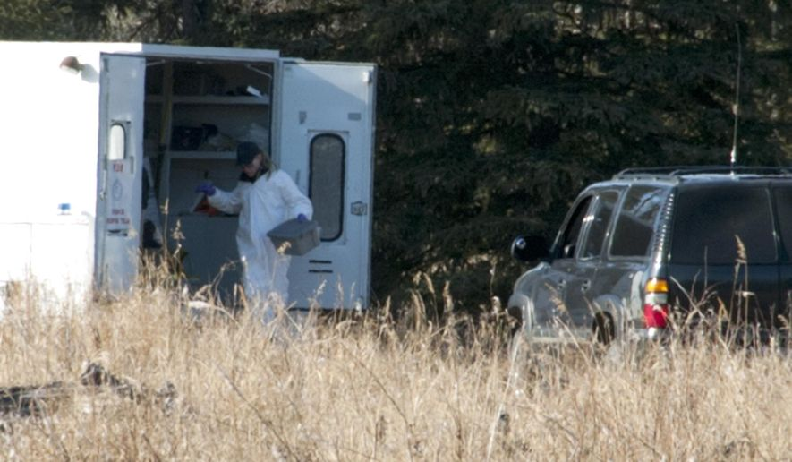 Investigators set up a temporary facility between Alpine Drive and Borgen Avenue  Sunday, March 22, 2015 after finding the remains of what Kenai Police believe to be a family that has been missing for nearly 10 months from their Kenai, Alaska home. While most of the land in the immediate area is state or federally owned, the place where police and the Federal Bureau of Investigation investigators is focusing their efforts, is a privately owned parcel which belongs to a woman from Sterling, Alaska. (AP Photo/Peninsula Clarion, Rashah McChesney)