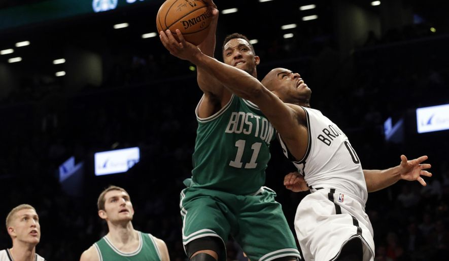 Boston Celtics guard Evan Turner (11) fouls Brooklyn Nets guard Jarrett Jack (0) during the first half of an NBA basketball game, Monday, March 23, 2015, in New York. (AP Photo/Mary Altaffer)