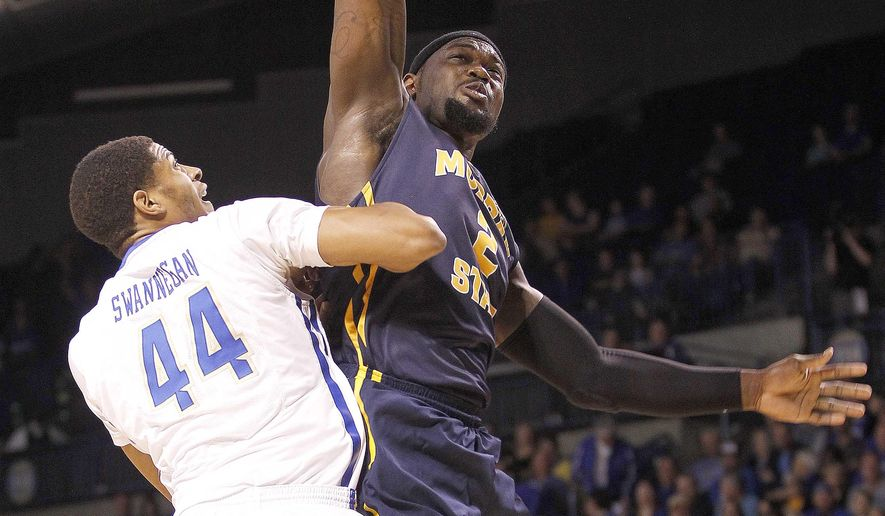 Murray State's Jonathan Fairell dunks over Tulsa's Brandon Swannegan in the first half of an NCAA college basketball game during the National Invitation Tournament, Monday, March 23, 2015, in Tulsa, Okla. (AP Photo/Dave Crenshaw)