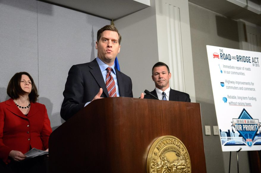 """House Speaker Kurt Daudt, R-Crown, center, speaks at a press conference unveiling the Republican transportation plan, Monday, March 23, 2015 in St. Paul, Minn.  Behind him, Rep. Joyce Peppin, R-Rogers and  House transportation committee chair Rep. Tim Kelly, R-Red Wing, as leading Republicans in the Minnesota Legislature unveil their alternative to Gov. Mark Dayton's 10-year, $11 billion roads, bridges and transit proposal. The GOP is promising a """"10-year, comprehensive approach to prioritizing road and bridge infrastructure.""""  (AP Photo/Star Tribune, Glen Stubbe)   MANDATORY CREDIT; ST. PAUL PIONEER PRESS OUT; MAGS OUT; TWIN CITIES LOCAL TELEVISION OUT"""