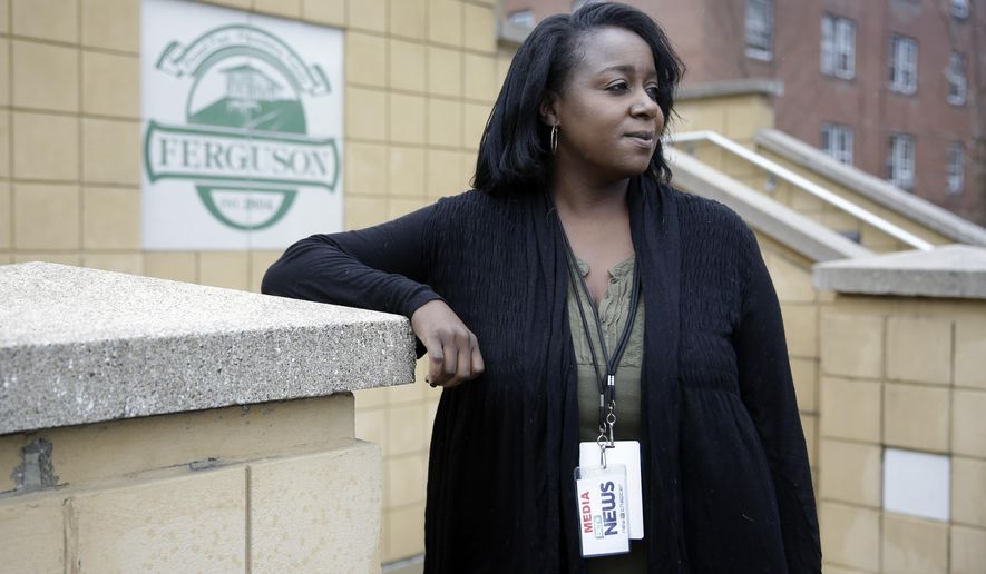 Freelance journalist Mary Moore poses for a portrait before entering Ferguson Municipal Court Tuesday, March 24, 2015, in Ferguson, Mo. Moore was charged with municipal violations after an arrest on Oct. 3., while covering a demonstration outside Ferguson police headquarters. The St. Louis-based videographer said she wants her reputation, and her criminal record, cleared.  (AP Photo/Jeff Roberson)