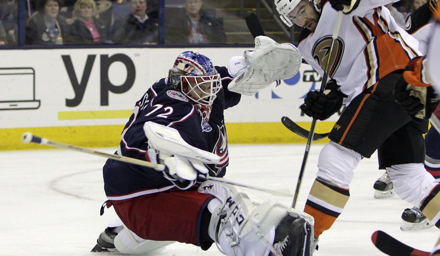 Columbus Blue Jackets' Sergei Bobrovsky, left, of Russia, makes a save against Anaheim Ducks' Kyle Palmieri during the first period of an NHL hockey game Tuesday, March 24, 2015, in Columbus, Ohio. (AP Photo/Jay LaPrete)