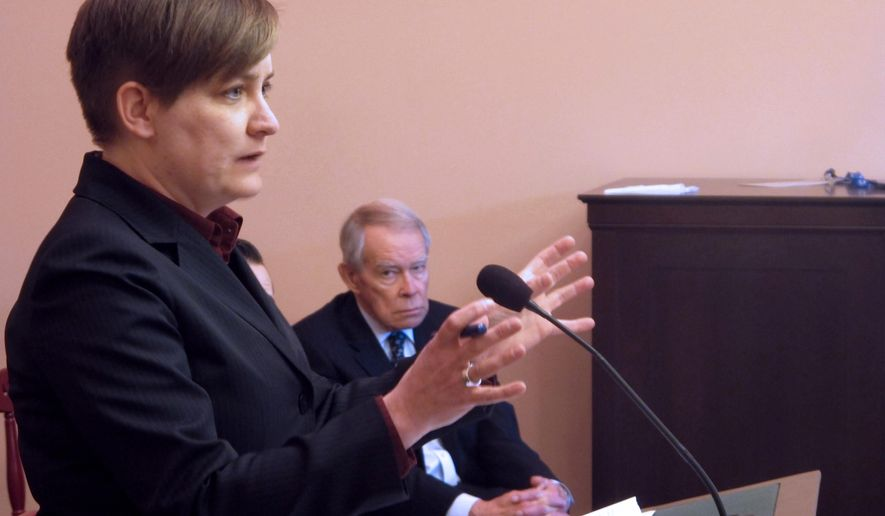 Amy Borror, left, lobbyist for the Ohio Public Defender's Office, explains her position that a bill extending the statute of limitations in rape cases based on DNA matches is unconstitutional as John Murphy, executive director of the Ohio Prosecuting Attorneys Association observes, on Tuesday, March 24, 2015, in Columbus, Ohio. Borror said proposed legislation unconstitutionally creates two classes of rape defendants--those whose cases involve DNA, and those whose cases don't. (AP Photo/Andrew Welsh-Huggins)