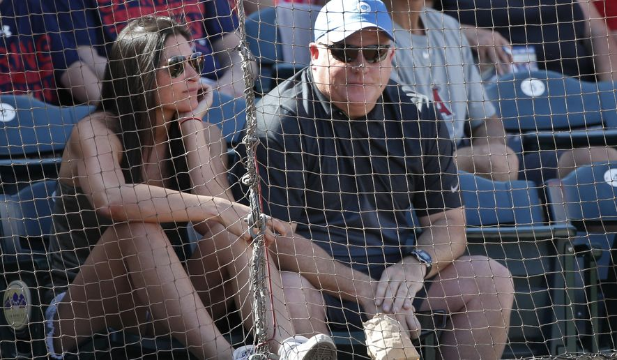 Philadelphia Eagles coach Chip Kelly enjoys a spring training baseball game watching the Texas Rangers and Los Angeles Angels Tuesday, March 24, 2015, in Surprise, Ariz.  (AP Photo/Lenny Ignelzi)