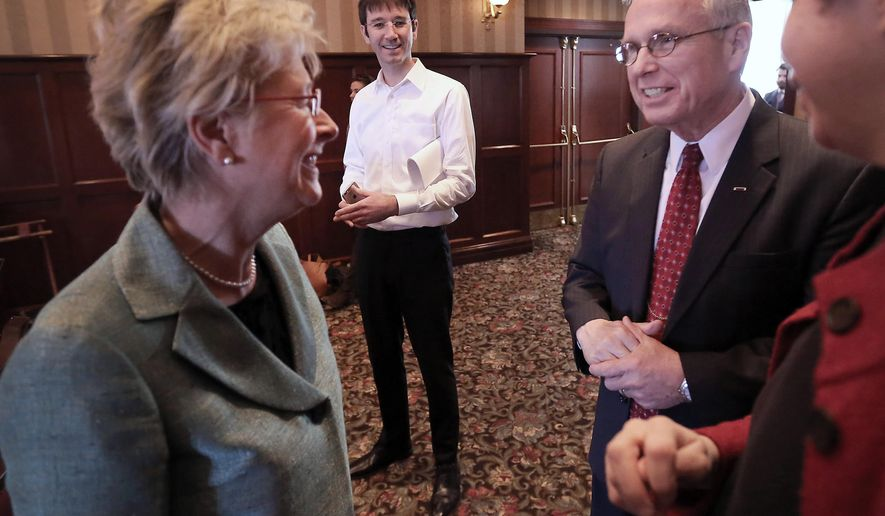 Wisconsin Supreme Court Justice Ann Walsh Bradley, left, and her challenger James Daley speak briefly before a Dane County Bar Association-sponsored debate at the Madison Club in Madison, Wis., Tuesday, March 24, 2015.(AP Photo/Wisconsin State Journal, John Hart)