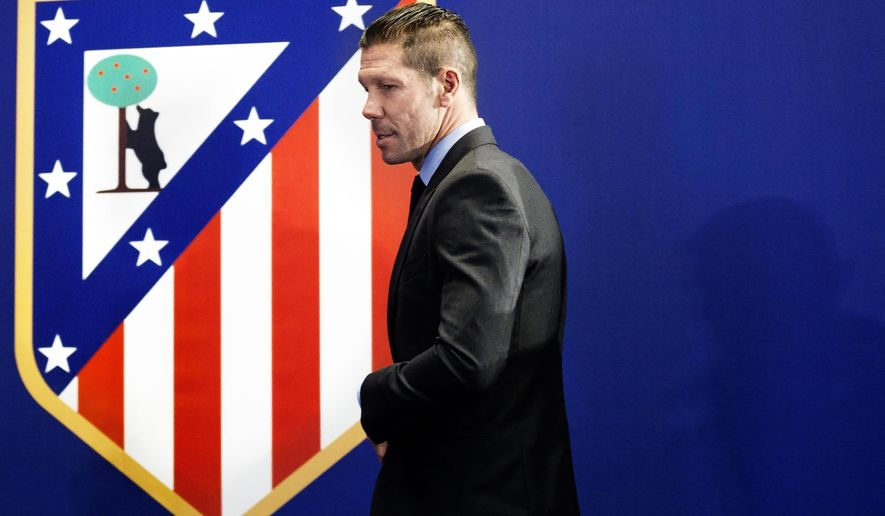 Atletico Madrid coach Diego Simeone arrives for a press conference at the Vicente Calderon stadium in Madrid, Spain, Tuesday, March 24, 2015. The former Argentina and Atletico midfielder, who took over as coach in December 2011, has renewed his contract with the Spanish champions for another five seasons, keeping him at the club until 2020. (AP Photo/Daniel Ochoa de Olza)