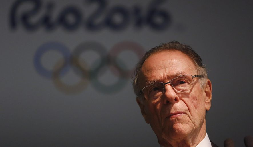 Brazil's Olympic Committee President Carlos Nuzman listens to a question during a press conference marking 500 days before the opening of the Rio 2016 Olympics in Rio de Janeiro, Brazil, Tuesday, March 24, 2015. Nuzman said Rio would emerge from the games more changed than 1992 host Barcelona or 1964's Tokyo. (AP Photo/Leo Correa)