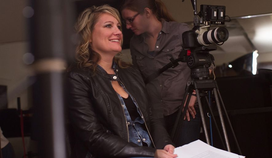 "Michigan filmmaker Amy S. Weber in the director's seat of her latest project, ""A Girl Like Her."" Ms. Weber hopes to change the conversation about bullying by focusing not on superior force but rather on love."