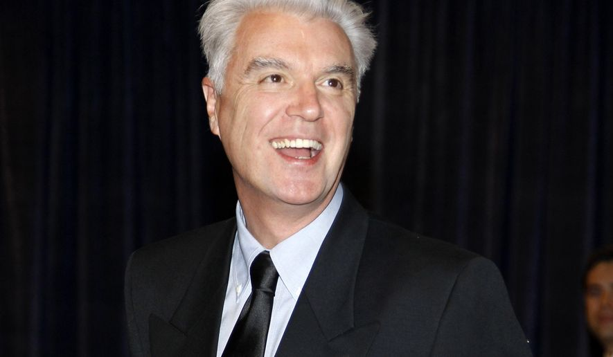 """FILE - In this April 30, 2011 file photo, musician David Byrne arrives for the White House Correspondents Dinner in Washington. Byrne crashed his own tribute concert, leading a marching band down the aisle at Carnegie Hall and, eventually, to an onstage dance party to the tune of """"Uptown Funk."""" He showed up at the end of an annual tribute that benefits music education. (AP Photo/Alex Brandon, File)"""