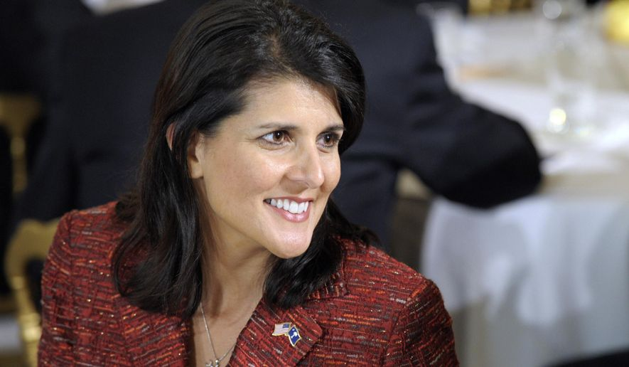 FILE - In this Feb. 27, 2012, file photo, South Carolina Gov. Nikki Haley waits for President Barack Obama to speak in the State Dining Room of the White House in Washington. Haley berated fellow Republicans in the South Carolina House for proposing to borrow about $500 million for building projects statewide. But an Associated Press review published Tuesday, March 24, found she has approved more than $1 billion in state-backed borrowing as head of the state's financial oversight board. (AP Photo/Susan Walsh, File)