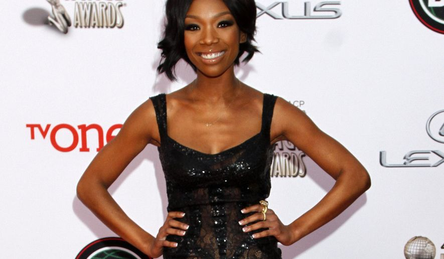 "FILE - In this Feb. 22, 2014 file photo, singer Brandy Norwood arrives at the 45th NAACP Image Awards  in Pasadena, Calif. Producers said Tuesday, March 24, 2015, that Norwood will make her Broadway debut next month as a woman behind bars in ""Chicago."" (Photo by Arnold Turner/Invision/AP, File)"