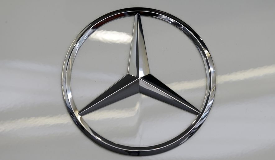 FILE - This Feb. 14, 2013 file photo shows a Mercedes logo on a Mercedes automobile at the Pittsburgh Auto Show in Pittsburgh. U.S. safety regulators on Tuesday, March 24, 2015 said Mercedes-Benz is recalling just over 30,000 CLS-Class cars in the U.S. because the LED tail lamps may not light properly on the sides. (AP Photo/Gene J. Puskar, File)