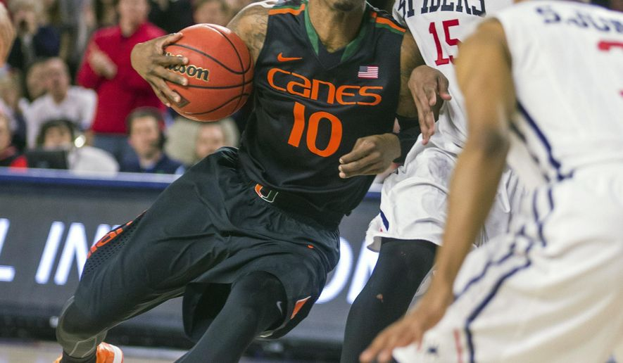 Miami guard Sheldon McClellan, left, drives around Richmond forward Terry Allen, right, during the NIT basketball tournament in Richmond, Va., on Tuesday, March 24, 2015.  Miami won 63-61.  (AP Photo/Zach Gibson)