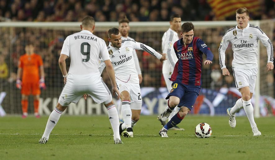 Real Madrid's Karim Benzema, left, Real Madrid's Raphel Varane, second left, Real Madrid's Toni Kroos, right, Real Madrid's Cristiano Ronaldo, rear center, and Real Madrid's goalkeeper Iker Casillas, left, watch as Barcelona's Lionel Messi, center, drybbles with the ball during a Spanish La Liga soccer match between FC Barcelona and Real Madrid at Camp Nou stadium, in Barcelona, Spain, Sunday, March 22, 2015. (AP Photo/Emilio Morenatti)