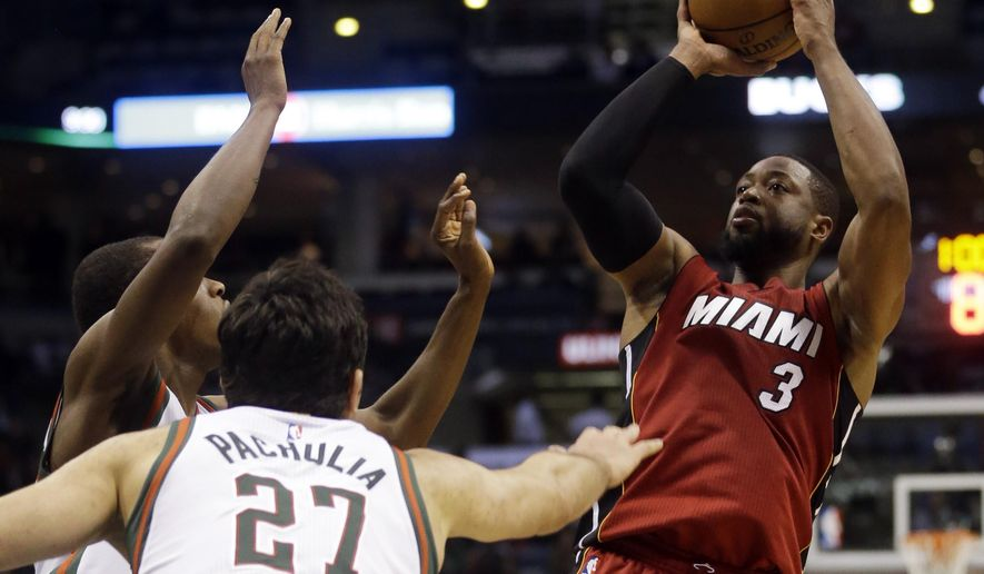 Miami Heat's Dwyane Wade shoots during the first half of an NBA basketball game against the Milwaukee Bucks on Tuesday, March 24, 2015, in Milwaukee. (AP Photo/Morry Gash)