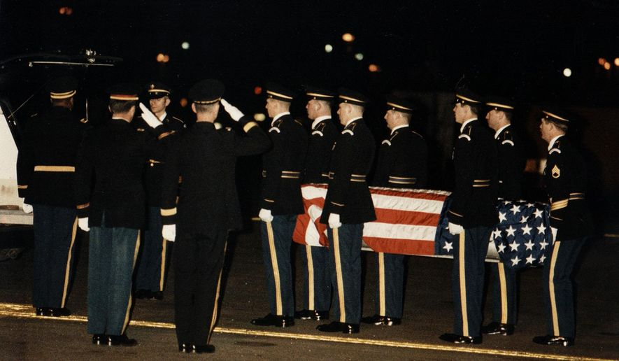 FILE - In this March 24, 1985 file photo honor guards of US Army carry the casket with the body of Major Arthur D. Nicholson to a hearse at Frankfurt's, Germany, Rhine-Main airbase, where Nicholson's body arrived from West Berlin aboard US Army C-12 plane. A Soviet sentry had shot and killed unarmed U.S. Maj. Arthur Nicholson, letting him bleed out where he fell next on the tank firing range he had been reconnoitering when he was on a patrol into communist East Germany as allowed by postwar agreements.  (AP Photo/file)