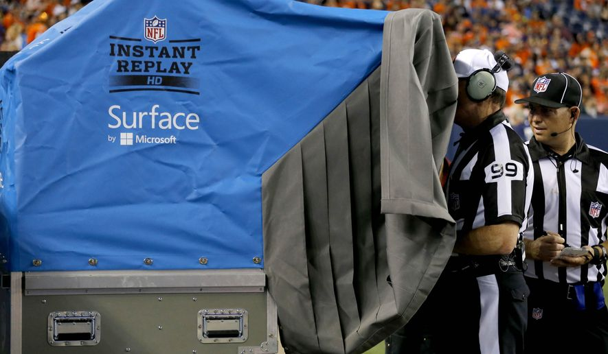 FILE - In this Aug. 7, 2014, file photo, referee Tony Corrente (99) watches the instant replay during the second half of an NFL preseason football game in Denver. NFL owners shot down nearly every video replay proposal brought to their meetings Tuesday, March 24, 2015, while approving several safety rules enhancements. (AP Photo/Jack Dempsey, File)