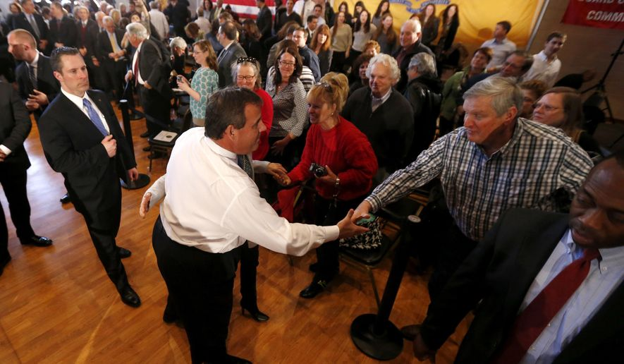 New Jersey Gov. Chris Christie, center, shakes hands with an audience member after a town hall meeting at the Hanover Township Community Center, Tuesday, March 24, 2015, in Whippany, N.J. (AP Photo/Julio Cortez)
