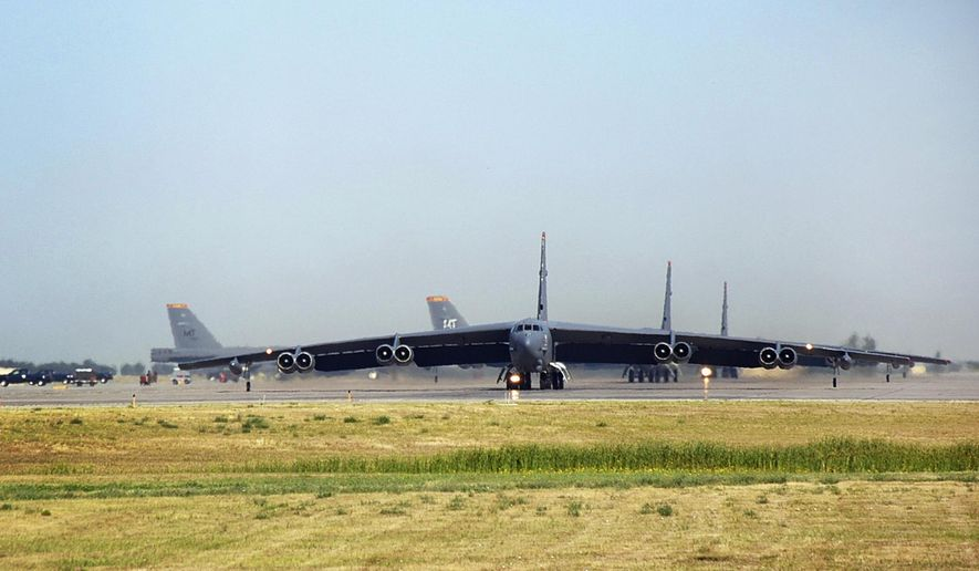 FILE - In this Aug. 9, 2007, file photo, B-52 bombers taxi to the runway at Minot Air Force Base in Minot, N.D. On Tuesday, March 24, 2015, the Federal Aviation Administration gave final approval for a plan to establish an enormous bomber training area over the northern Plains that advocates say will improve military training and save money. The plan would expand the Powder River Training Complex over the Dakotas, Montana and Wyoming. The move quadruples the training airspace, making it the largest over the continental United States. (AP Photo/The Minot Daily News, Eloise Ogden, File)