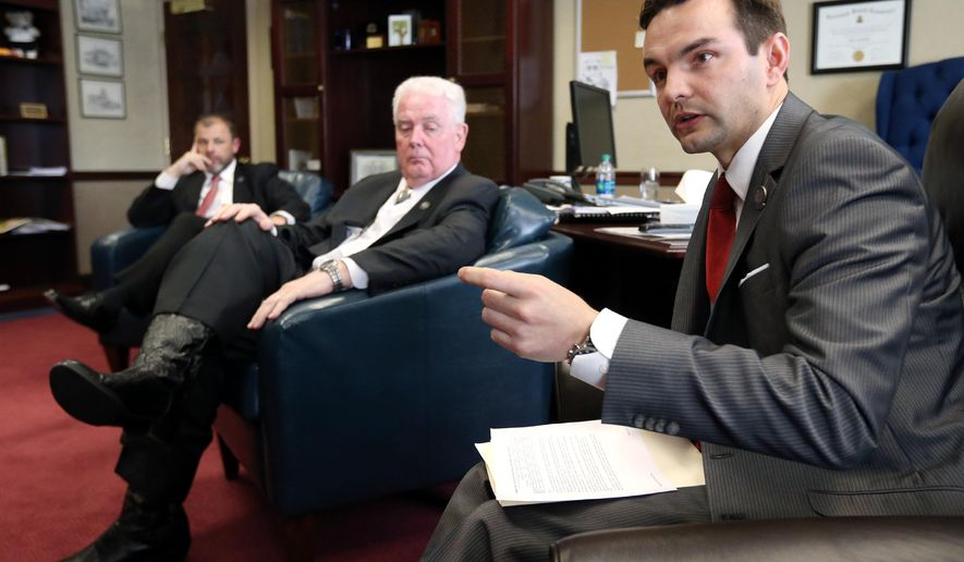 Nevada Assembly Republican leaders, from left, Paul Anderson, John Hambrick and Derek Armstrong talk about a tax plan that offers additional options to those laid out last week by Nevada Gov. Brian Sandoval during a meeting at the Legislative Building in Carson City, Nev., Monday, March 23, 2015. (AP Photo/Cathleen Allison)