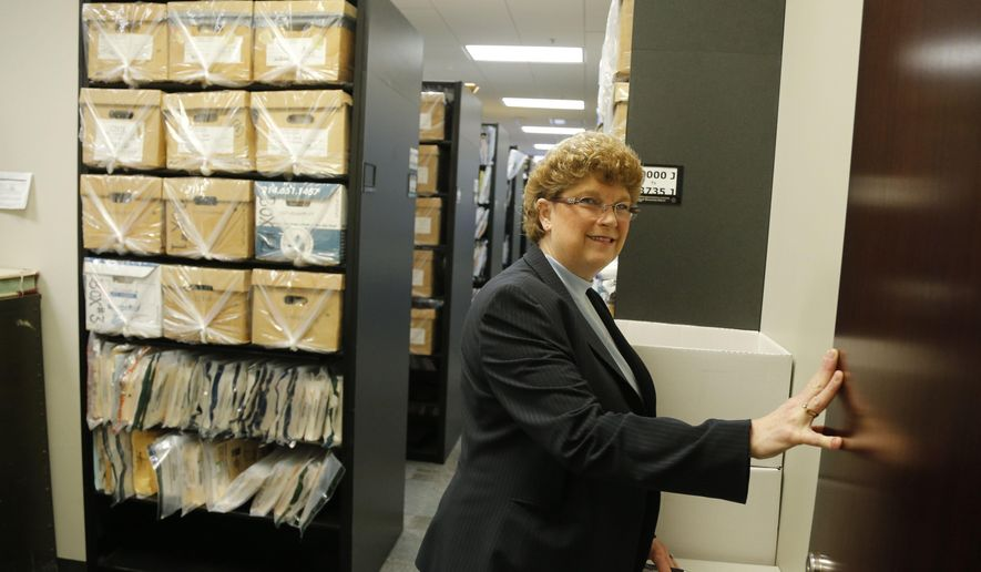 In a Friday, March 20, 2015 photo, Paula Ford, assistant manager of closed records, stands in the doorway of the secure room holding sealed court records in the Tarrant County District Clerk's office in Fort Worth, Texas. A nearly forgotten gem _ an old Tarrant County court file that included documents trying to prevent the late, famed attorney Melvin Belli from representing Jack Ruby, who shot Lee Harvey Oswald _ was recently unearthed . (AP Photo/Star-Telegram, Rodger Mallison) MAGS OUT; (FORT WORTH WEEKLY, 360 WEST); INTERNET OUT