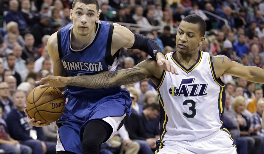 Utah Jazz guard Trey Burke (3) defends against Minnesota Timberwolves guard Zach LaVine, left, in the second quarter in an NBA basketball game Monday, March 23, 2015, in Salt Lake City. (AP Photo/Rick Bowmer)