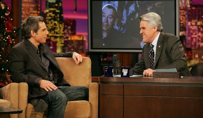 "Actor Ben Stiller, left, talks with host Jay Leno after viewing a clip from Stiller's new movie ""Meet the Fockers"" during a taping of ""The Tonight Show with Jay Leno"" at NBC Studios in Burbank, Calif. on Friday, Dec. 17, 2004. (AP Photo/Danny Moloshok)"