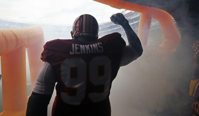 Washington Redskins defensive end Jarvis Jenkins (99) reacts to his introduction from the tunnel during the first half of an NFL football game against the Dallas Cowboys in Landover, Md., Sunday, Dec. 28, 2014. (AP Photo/Alex Brandon)