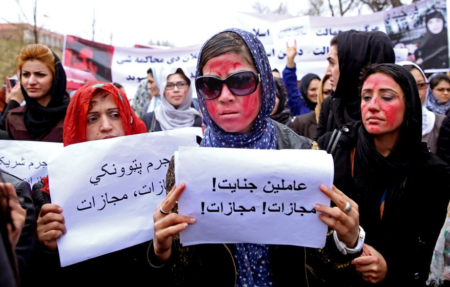 Afghan women have a long way to go before society accepts equal rights to education and to work, according to an inspector general's report to Congress. (Associated Press/File)