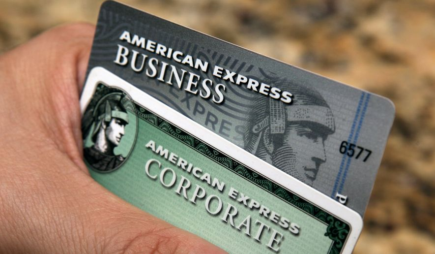 In this Jan. 20, 2010, file photo, American Express cards are posed for a photograph in Phoenix. Amex's stock is down 11 percent this year, making it the second-biggest decliner on the Dow Jones industrial average. (AP Photo/Ross D. Franklin, File)