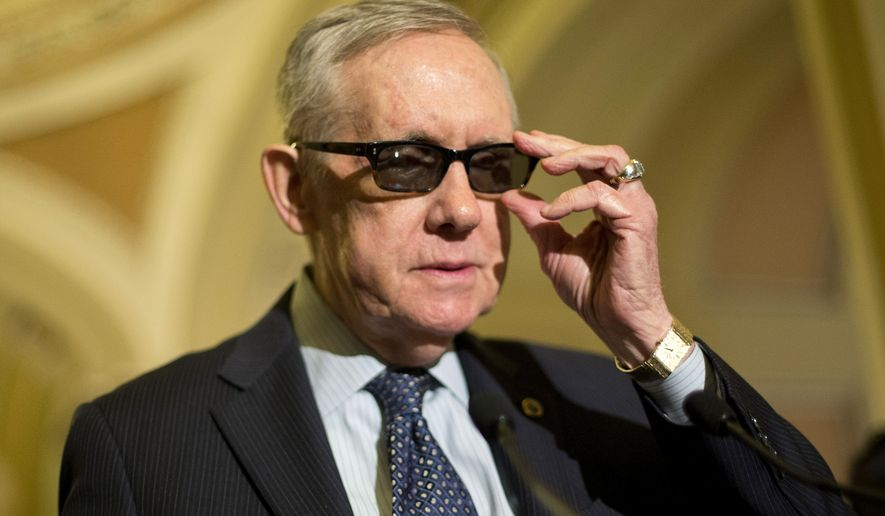 Senate Minority Leader Harry Reid of Nev. adjusts his glasses as he speaks to reporters on Capitol Hill in Washington, Tuesday, March 24, 2015, following a policy luncheon. Reid is wearing special glasses as part of his recovery from injuries suffered in an exercise accident in January. (AP Photo/Pablo Martinez Monsivais)