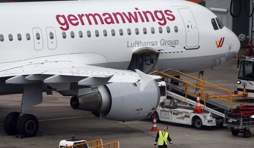 In this Oct. 16, 2014, file photo an Airbus 320 of Germanwings is parked at the airport as their pilots went on strike in Duesseldorf, Germany. A Germanwings Airbus plane with at least 142 passengers, two pilots and four flight attendants on board has crashed in the Alps region Tuesday, March 24, 2015. (AP Photo/Frank Augstein)