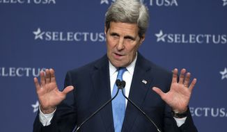 Secretary of State John Kerry gestures while addressing the SelectUSA Investment Summit, hosted by the Commerce Department, Tuesday, March 24, 2015, in National Harbor, Md. (AP Photo/Cliff Owen)