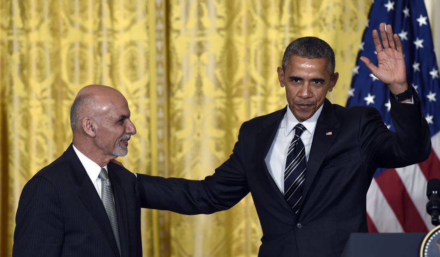 President Barack Obama waves as he and Afghanistan's President Ashraf Ghani conclude their news conference in the East Room of the White House in Washington, Tuesday, March 24, 2015. Ghani represents Obama's last, best hope to make good on his promise to end America's longest war by the time he leaves office, keeping just a thousand or so troops at the embassy to coordinate security. (AP Photo/Susan Walsh)
