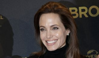 "Director Angelina Jolie poses for photographers during a photo call for her film ""Unbroken"" in Berlin, Germany, in this Nov. 27, 2014, file photo. Jolie announced in an op-ed in The New York Times on Tuesday, March 24, 2015, that she had her ovaries and fallopian tubes removed to prevent cancer. (AP Photo/Michael Sohn, File)"