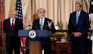 Chief Executive of Afghanistan Abdullah Abdullah, speaks while State Secretary John Kerry, right and Afghan President Ashraf Ghani, left, listen, during a dinner reception at the Department of State, in Washington, Tuesday, March 24, 2015. (AP Photo/Manuel Balce Ceneta)