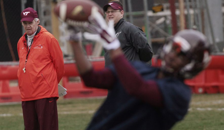 Virginia TechcCoach Frank Beamer, left, watches the first day of spring practice for the NCAA college football team, Tuesday, March 24, 2015, in Blacksburg, Va. (AP Photo/The Roanoke Times, Heather Rousseau)