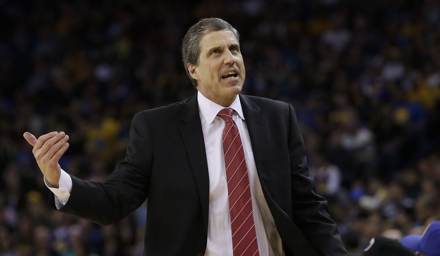 Washington Wizards head coach Randy Wittman gestures during the first half of an NBA basketball game against the Golden State Warriors in Oakland, Calif., Monday, March 23, 2015. The Warriors won 107-76. (AP Photo/Jeff Chiu)