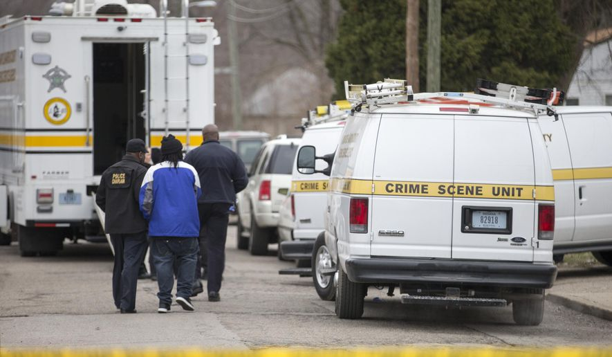 Indianapolis Metropolitan Police Department (IMPD) personnel investigate at 3145 North Harding Street in Indianapolis, at a scene involving four homicide victims, Tuesday, March 24, 2015. Indianapolis Police Chief Rick Hite says three women and a man have been shot to death in the home. Hite says the shootings don't appear random and likely occurred Tuesday morning. (AP Photo/The Indianapolis Star, Robert Scheer)  NO SALES