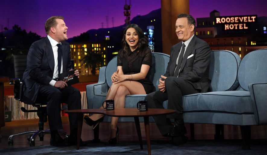 "This photo released by CBS shows James Corden, left, chatting with his first guests, Tom Hanks, right, and Mila Kunis, on ""The Late Late Show with James Corden,"" premiering Monday, March 23, 2015 (12:37 -- 1:37 a.m. ET/PT) on the CBS Television Network.  (AP Photo/CBS, Monty Brinton)"