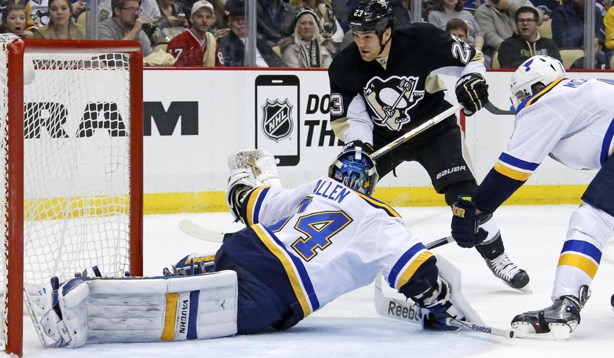 Pittsburgh Penguins' Steve Downie (23) scores over St. Louis Blues goalie Jake Allen (34) during the second period of an NHL hockey game in Pittsburgh on Tuesday, March 24, 2015. (AP Photo/Gene J. Puskar)