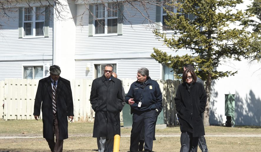 Detroit Police Chief James Craig and other law enforcement have a short briefing to media as law enforcement investigates in Detroit where the bodies of 2 children described as pre-teens or teens were found in a freezer, Tuesday, March 24, 2015 by 36th District Court officers carrying out an eviction at the Martin Luther King Apartments. Their names were not immediately released. Autopsies will be performed by the Wayne County medical examiner's office to determine how they died. WXYZ-TV reports that two other children, ages 11 and 17, have been taken from the home and placed with protective services.