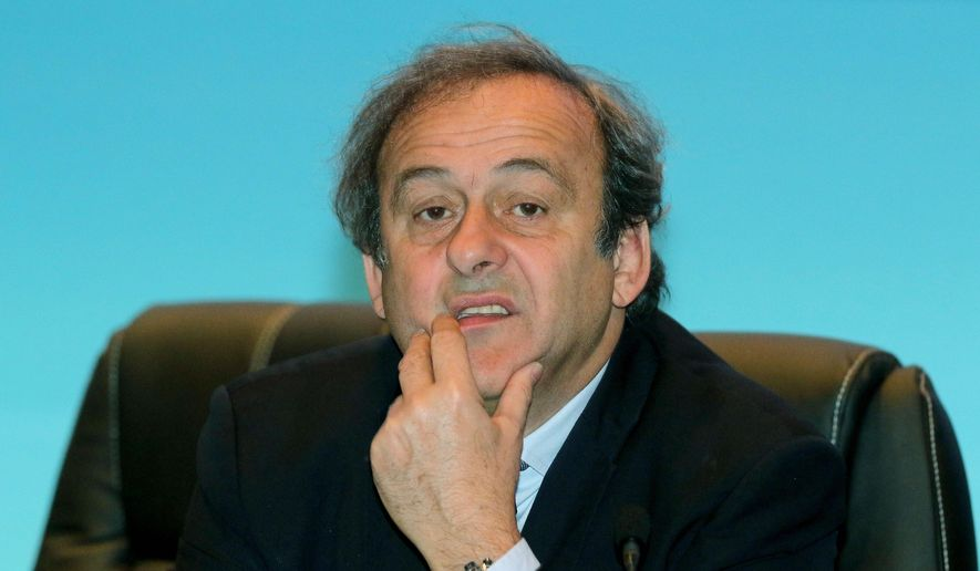 UEFA President Michel Platini waits for the start of the 39th Ordinary UEFA Congress in Vienna, Austria, Tuesday, March 24, 2015. (AP Photo/Ronald Zak)
