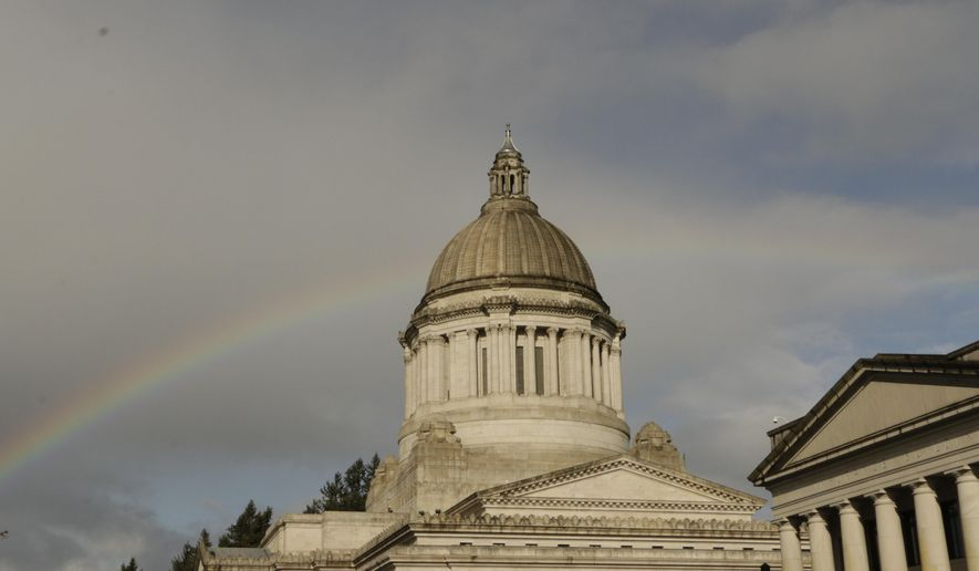 A rainbow is seen behind the Washington state Capitol, Tuesday, March 24, 2015, in Olympia, Wash. Lawmakers are in the middle of a 105-day legislative session. (AP Photo/Rachel La Corte)