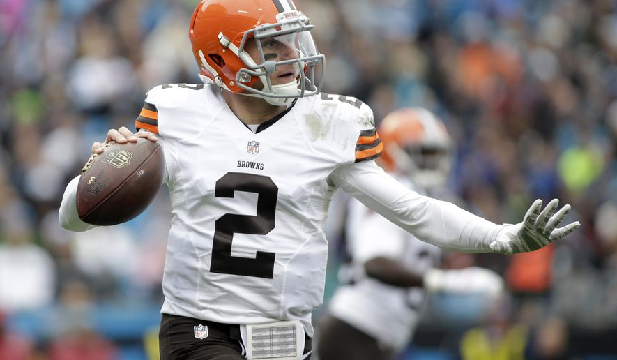 FILE - In this Sunday, Dec. 21, 2014 file photo, Cleveland Browns' Johnny Manziel (2) looks to pass against the Carolina Panthers in the first half of an NFL football game in Charlotte, N.C. Browns coach Mike Pettine expects quarterback Johnny Manziel to take part in the team's practices next month after leaving rehab, Tuesday, March 24, 2015. (AP Photo/Bob Leverone, File)
